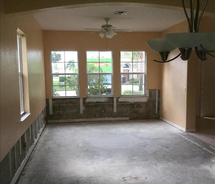 empty living room, walls cut away from a flood